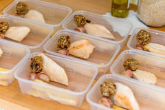 Meal prep. Part filled containers. Roast chicken dinners. Meal prep. Home made meals, part way through filling containers to be frozen for later use. Roast Royalty Free Stock Photo