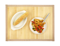 Meal of rigatoni with a piece of garlic bread Royalty Free Stock Photography