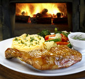 Meal with roasted chicken seen up close Stock Image