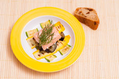Meal with salmon filet and courgettes Royalty Free Stock Images