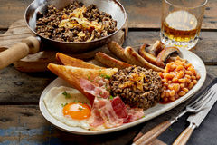 Meal of Scottish haggis served with whisky Royalty Free Stock Photos