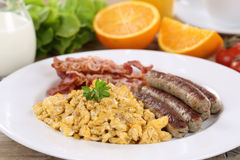 Meal with scrambled eggs, sausages and bacon Royalty Free Stock Photography