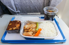 Meal serve on airplane with bakery and soft drink Royalty Free Stock Photos
