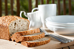Meal setting with sliced banana bread Royalty Free Stock Image