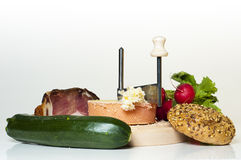A meal or snack consisting of bread, cheese, bacon. Green squash and radish Stock Image