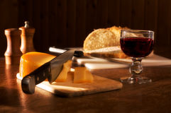 Meal in a sunset mood. Dinner in a sunset mood ( rustic wine, bread cheese, pepper, salt Stock Images