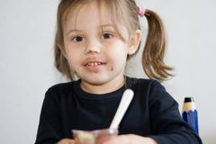 Meal time. Little girl eating her chocolate pudding Royalty Free Stock Images