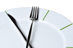 Meal Time. Clock made of knife and fork, isolated on white background Stock Photography