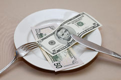 Meal time. Pay the bill for meal after a dinner Royalty Free Stock Photography