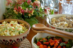 Meal Time!. A dinner table filled with 3 salad bowls and decorated with wild honeysuckle Royalty Free Stock Image