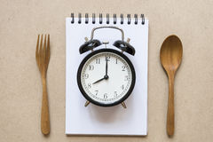 Meal time with alarm clock Royalty Free Stock Image