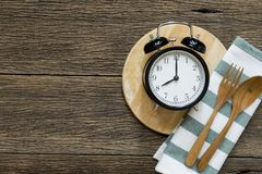 Meal time with alarm clock, breakfast Royalty Free Stock Photography