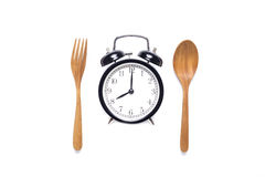 Meal time with alarm clock, breakfast Royalty Free Stock Image