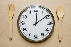 Meal time with alarm clock Stock Images