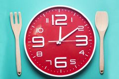 Meal time with alarm clock, lunch time Stock Images