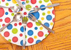 Meal Time Creativity. Meal Utensils on a circle heat pad Royalty Free Stock Images