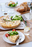 Meal time with quiche. Lunch time meal with quiche and side salad, simple snack food Royalty Free Stock Image