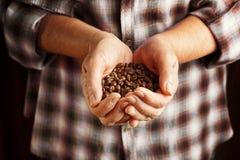 Senior woman holding coffee beans Stock Photo