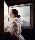 Young woman looking for some snack in fridge late. At night stock images