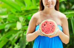 Young woman with watermelon in hands Royalty Free Stock Photos