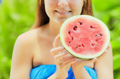 Young woman with watermelon in hands Stock Images