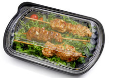 Meal to go, Fast food. Turkey breast on rucola in a box Stock Photo