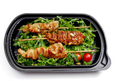 Meal to go, Fast food. Turkey breast on rucola in a box Royalty Free Stock Photography