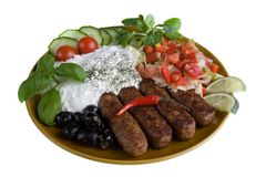 Meal with tzatziki, cevapcici and salad Stock Images