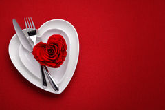 Meal on Valentines Day. Red rose on white dish.Meal on Valentines Day Royalty Free Stock Photo
