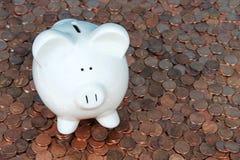 Mealheiro em moedas de um centavo Foto de Stock Royalty Free