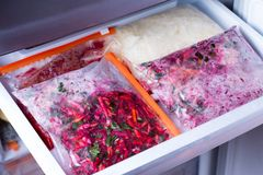 Meals in bags in the refrigerator. Frozen food Stock Photo
