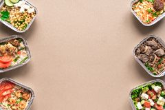 Daily meals delivery. Daily meals in foil boxes, top view, copy space, flat lay. Healthy food delivery concept. Fitness nutrition for diet or clean eating royalty free stock photos