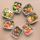 Daily meals delivery. Daily meals in foil boxes, top view, flat lay. Healthy food delivery concept. Fitness nutrition for diet or clean eating stock image