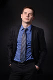 Mean businessman. Portrait of businessman  on black background Stock Photos