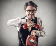 Mean businessman hanging the phone Royalty Free Stock Photos