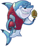 Mean Cartoon Football Shark with Helmet and Ball. Vector cartoon clip art illustration of a tough mean smiling shark mascot wearing a football uniform and pads stock illustration