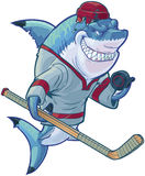 Mean Cartoon Hockey Shark with Stick and Puck. Vector cartoon clip art illustration of a tough mean smiling shark mascot wearing a hockey jersey and helmet while stock illustration