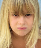 Mean girl. A portrait of a blond girl with a mean look on her face Royalty Free Stock Images