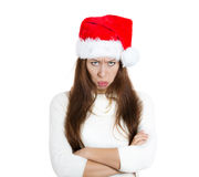 Mean, grumpy, unhappy, annoyed young woman, wife in red santa claus hat arms crossed folded looking at you Royalty Free Stock Images