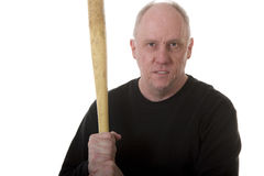 Mean Looking Guy with Bat. An older mean guy in a black shirt holding a baseball bat with a threatening look Royalty Free Stock Photos