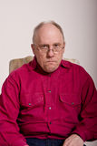 Mean Looking Man In Red Shirt Royalty Free Stock Images