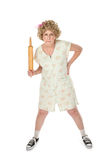 Mean Mama. Annoyed housewife with rolling pin on white background royalty free stock photo