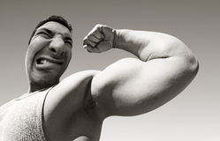 Mean man with big muscles royalty free stock images