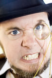 Mean Monocle Man. Clinches Teeth Tightly Together Is An Fuming Facial Expression Royalty Free Stock Image