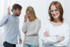 Mean and nosy mother. Picture of mean nosy mother and marital conflict Stock Image