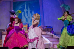 Mean stepmother and stepsisters. GREEN BAY, WI - FEBRUARY 10: Cinderella's mean stepmother & stepsisters make fun of dress at the Disney Princesses show at the Stock Photo