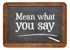 Mean what you say on blackboard Stock Photography