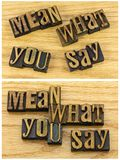 Mean what you say message letterpress. Letterpress block letters words message mean what you say honest honesty ethical quote teaching goal concept Royalty Free Stock Photography
