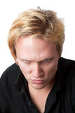 Mean Young Man. Closeup of mean young man on white background Royalty Free Stock Photo