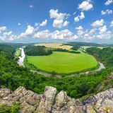 Meander of river under mountains. View on landscape with river and beautifull clouds Royalty Free Stock Images